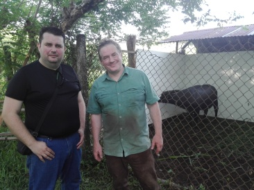 Joel Sartore and Pierre at the Gene Pool Farm, photographing the last Tamaraw under human care.